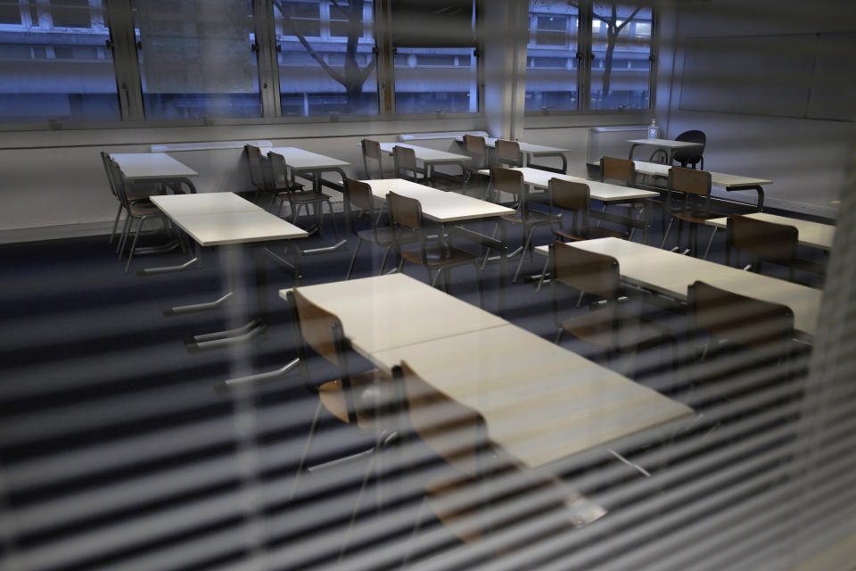 An empty classroom is pictured at the MHS, Meo High School private college, in Paris on Tuesday, Feb. 9, 2021. More than three dozen police officers descended on the small private school, blocked students inside their classrooms, took photos everywhere, even inside the refrigerator, and grilled the school director in her office. Such operations illustrate French efforts to fight extremism as lawmakers prepare to vote on a bill aimed at snuffing it out. (AP Photo/Francois Mori)