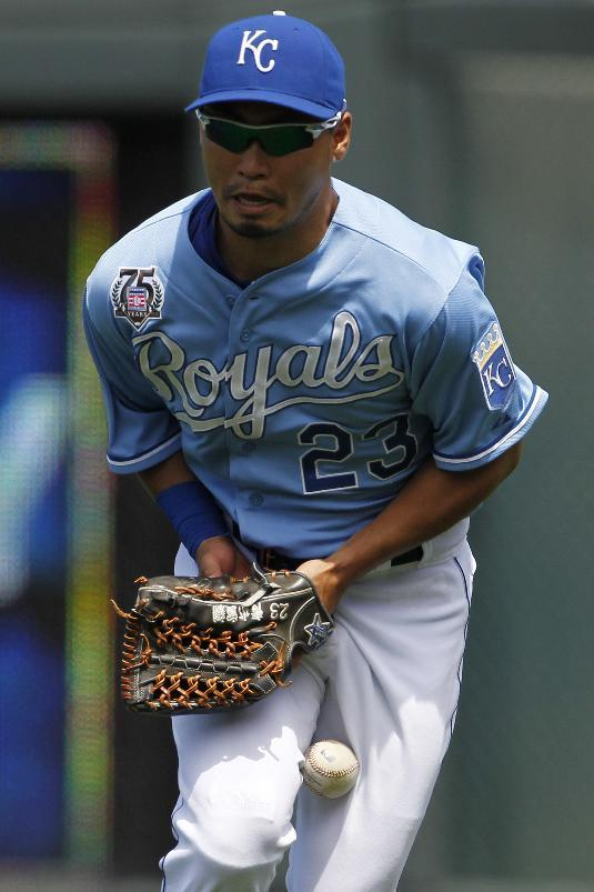 Kansas City Royals right fielder Norichika Aoki is unable to come up with a fly ball hit by Cleveland Indians' Asdrubal Cabrera in the fifth inning of a baseball game at Kauffman Stadium in Kansas City, Mo., Sunday, July 27, 2014. Cabrera singled on the play. (AP Photo/Colin E. Braley)