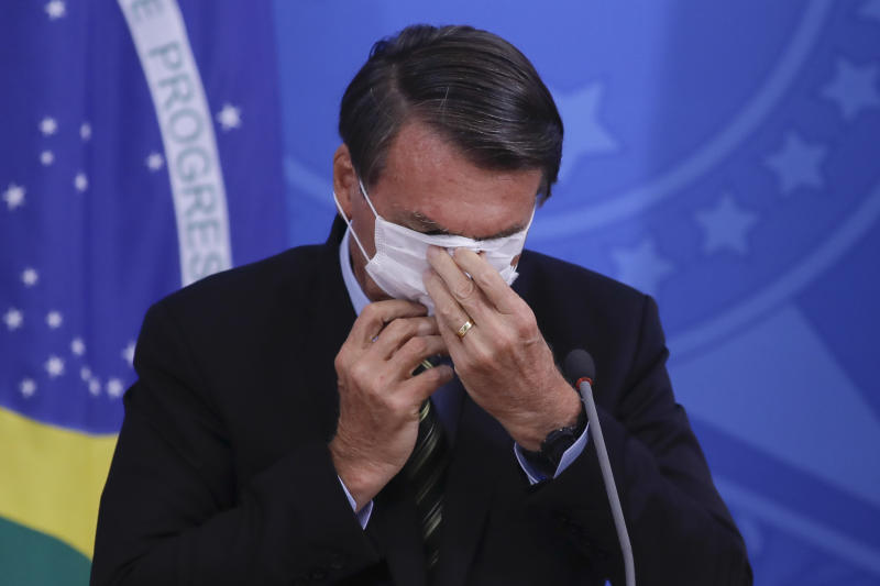Brazilian President Jair Bolsonaro talks during a press conference regarding the COVID-19, coronavirus pandemic at the Planalto Palace, Brasilia on March 18, 2020. (Photo by Sergio LIMA / AFP) (Photo by SERGIO LIMA/AFP via Getty Images)