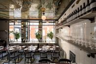 """<p><strong>Tell us about your first impressions when you arrived.</strong><br> Your first thought might be, """"Is that it?"""" With no more than 42 seats, the place—with its cracked subway tiles and an Art Deco ceiling—is teeny-tiny. Yet, it boasts a larger-than-life personality thanks, in part, to Carmina Lebrero, one of the original owners who partnered with Riccardo Giraudi of Beef Bar Monaco (and other meat-centric spots) to reopen it following years of relapse. Most evenings, Lebrero meanders about with her ice-chilled white wine stopping to chat with diners at each of the black marble-top tables that fill the room. The intimate, yet upscale hot spot hosts late-night goings-on that are hidden from the outside world thanks to giant vases of fresh flowers and grandiose candelabras in the windows.</p> <p><strong>What was the crowd like?</strong><br> In its '90s heyday, this Argentine steakhouse for the fashionable jet set was more about seeing and being seen than it was its <em>bife de lomo.</em> While its clientele is still a chic and boisterous bunch, carnivores who may appreciate the likes of smoked Kobe beef ham—raised in Japan and cured in Spain for over a year—are now also among its regulars.</p> <p><strong>What should we be drinking?</strong><br> Thanks to its prime people-watching atmosphere and yacht-inspired back bar designed by the architecture firm Humbert & Poyet, you could easily come here just for a coupe or a bottle of Malbec from Mendoza. Mixed drinks are South American-inspired and divided as such on the menu: There's the Cuban ginger mojito, the Mexican margarita, the Brazilian caipirinha, and the Peruvian pisco sour. In addition, they also craft their own signature drinks with likeminded south-of-the-border ingredients such as the Pisco pas Pisco (made with brandy, avocado purée, lime juice, coriander, and pepper) and the Misterio (made with mezcal, grapefruit juice, carrot syrup, cumin, and cardamon).</p> <p><strong>Main event: the food. Give us th"""