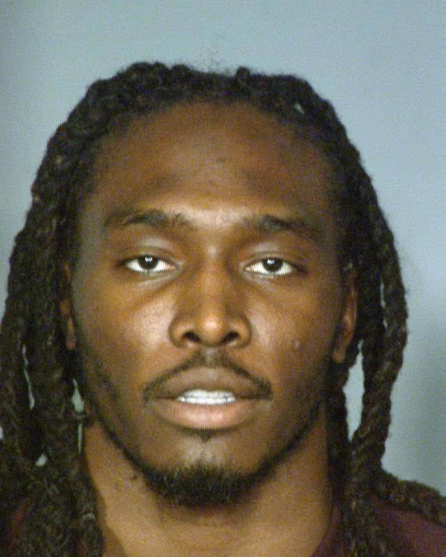 LAS VEGAS, NV - MARCH 10: In this booking photo provided by the Las Vegas Metropolitan Police Department, Denver Broncos safety Quinton Carter poses for his mugshot March 10, 2013 in Las Vegas, Nevada. Carter is facing criminal charges that he allegedly cheated during a craps game March 9 at a Las Vegas casino. (Photo by Las Vegas Metropolitan Police Department via Getty Images)