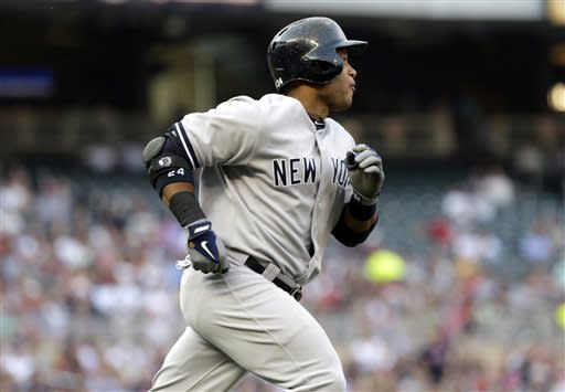New York Yankees' Robinson Cano heads to first on a solo home run off Minnesota Twins pitcher Scott Diamond in the first inning of a baseball game, Monday, July 1, 2013, in Minneapolis. (AP Photo/Jim Mone)