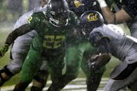Oregon defender Derrick Malone Jr., left, moves in on California running back Brendan Bigelow during the first half of an NCAA college football game in Eugene, Ore., Saturday, Sept. 28, 2013. (AP Photo/Don Ryan)