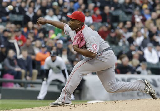Los Angeles Angels starter Jerome Williams throws against the Chicago White Sox during the first inning of a baseball game in Chicago, Saturday, May 11, 2013. (AP Photo/Nam Y. Huh)