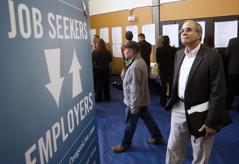FILE - In this April 24, 2012, file photo, job seeker Alan Shull attends a job fair in Portland, Ore.  The number of people applying for U.S. unemployment benefits ticked down last week after dropping sharply the previous week, evidence hiring could pick up this month. Weekly applications dropped 1,000 to a seasonally adjusted 367,000 in the week ending May 5, the Labor Department said Thursday, May 10, 2012. The previous week's figure was revised up slightly.  (AP Photo/Rick Bowmer, File)