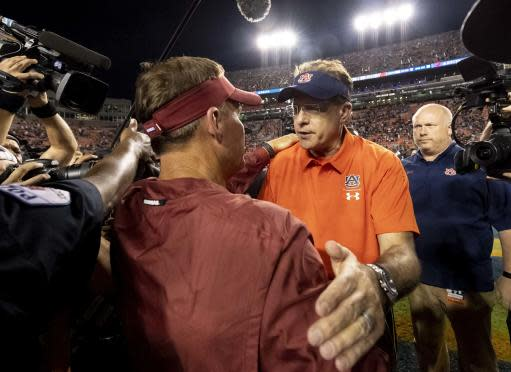 Auburn head coach Gus Malzahn greets Arkansas head coach Chad Morris at midfield after an NCAA college football game, Saturday, Sept. 22, 2018, in Auburn, Ala. (AP Photo/Vasha Hunt)