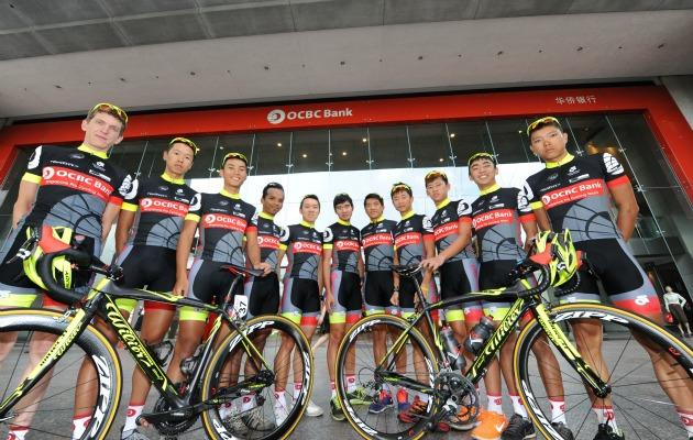 Members of the OCBC Singapore Pro Cycling Team (from left) Thomas Rabou, Ho Jun Rong, Lemuel Lee, Ahmad Haidar bin Anuawar, Marcus Leong, Phuchong Saiudomsin, Loh Sea Keong, Goh Choon Huat, Ryan Chan, Low Ji Wen and Timothy Lim pose in front of the OCBC Centre during the team's media launch event on Monday.
