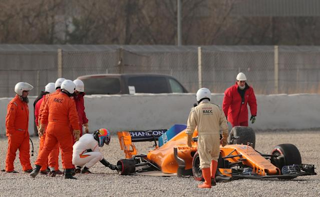 F1 Formula One - Formula One Test Session - Circuit de Barcelona-Catalunya, Montmelo, Spain - February 26, 2018. Fernando Alonso of McLaren inspects his car after losing a rear tyre during testing. Picture taken February 26, 2018. REUTERS/Albert Gea