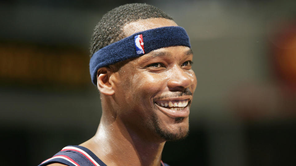 Clifford Robinson smiling during a Nets game.
