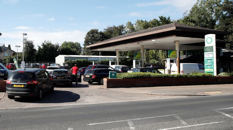 Vehicles queue up to enter the BP petrol station, in Harpenden