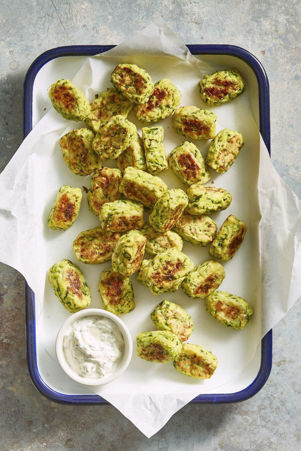 """<p>Instead of using the oven, blast these veggie tots in the air fryer for an extra-crispy crust.</p><p><em><a href=""""https://www.goodhousekeeping.com/food-recipes/a45726/zucchini-tots-recipe/"""" rel=""""nofollow noopener"""" target=""""_blank"""" data-ylk=""""slk:Get the recipe for Zucchini Tots »"""" class=""""link rapid-noclick-resp"""">Get the recipe for Zucchini Tots »</a></em></p>"""