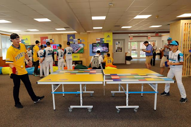 """Kevin Newman of the <a class=""""link rapid-noclick-resp"""" href=""""/mlb/teams/pittsburgh/"""" data-ylk=""""slk:Pittsburgh Pirates"""">Pittsburgh Pirates</a> plays ping pong with Andrew Mhoon of the Northwest team in the game room at the Little League complex prior to the 2019 Little League Classic between the <a class=""""link rapid-noclick-resp"""" href=""""/mlb/teams/chi-cubs/"""" data-ylk=""""slk:Chicago Cubs"""">Chicago Cubs</a> and the Pittsburgh Pirates. (Alex Trautwig/MLB Photos via Getty Images)"""