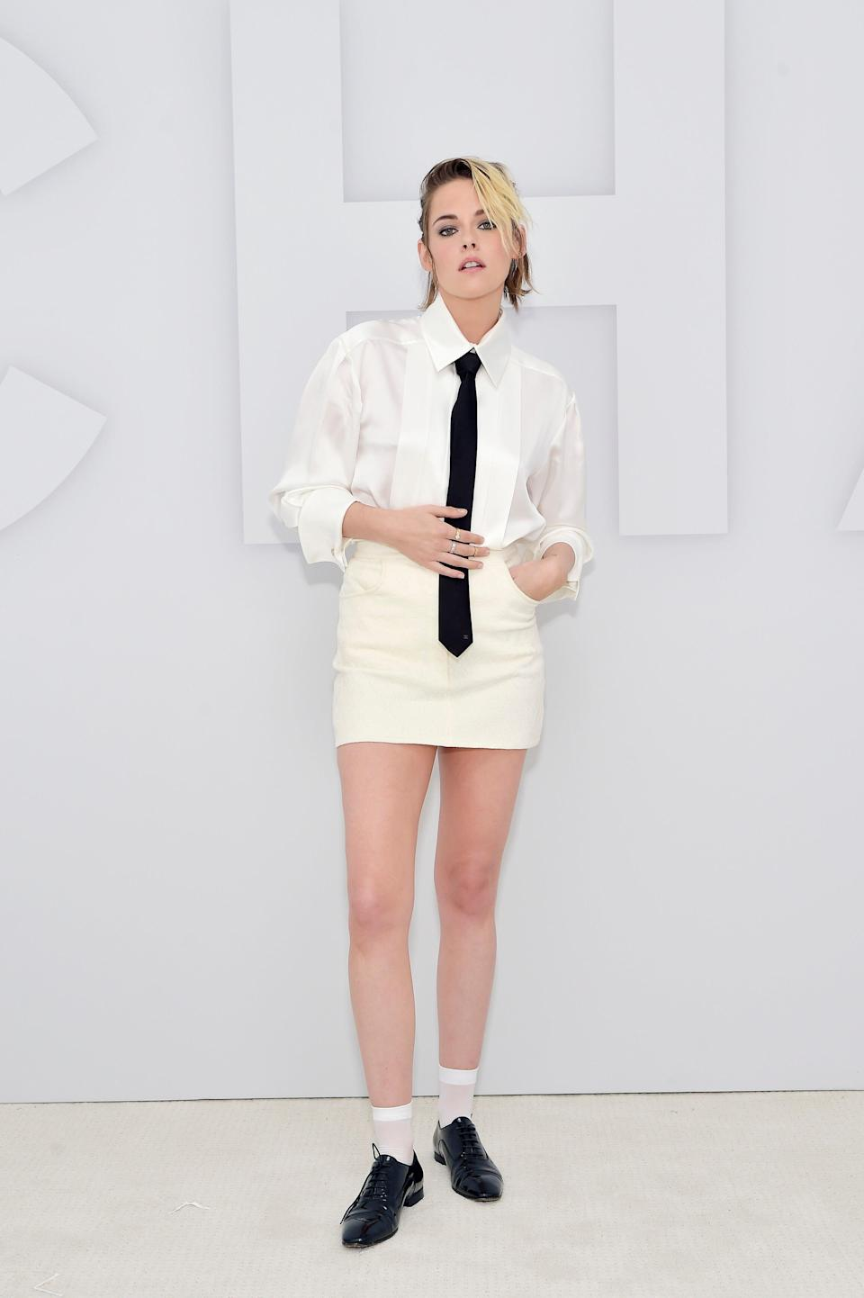 <h2>Kristen Stewart, Chanel</h2><br>Like Robbie, Kristen Stewart also got dressed up to pose as if she was actually at the Chanel show in this back-to-school inspired look.