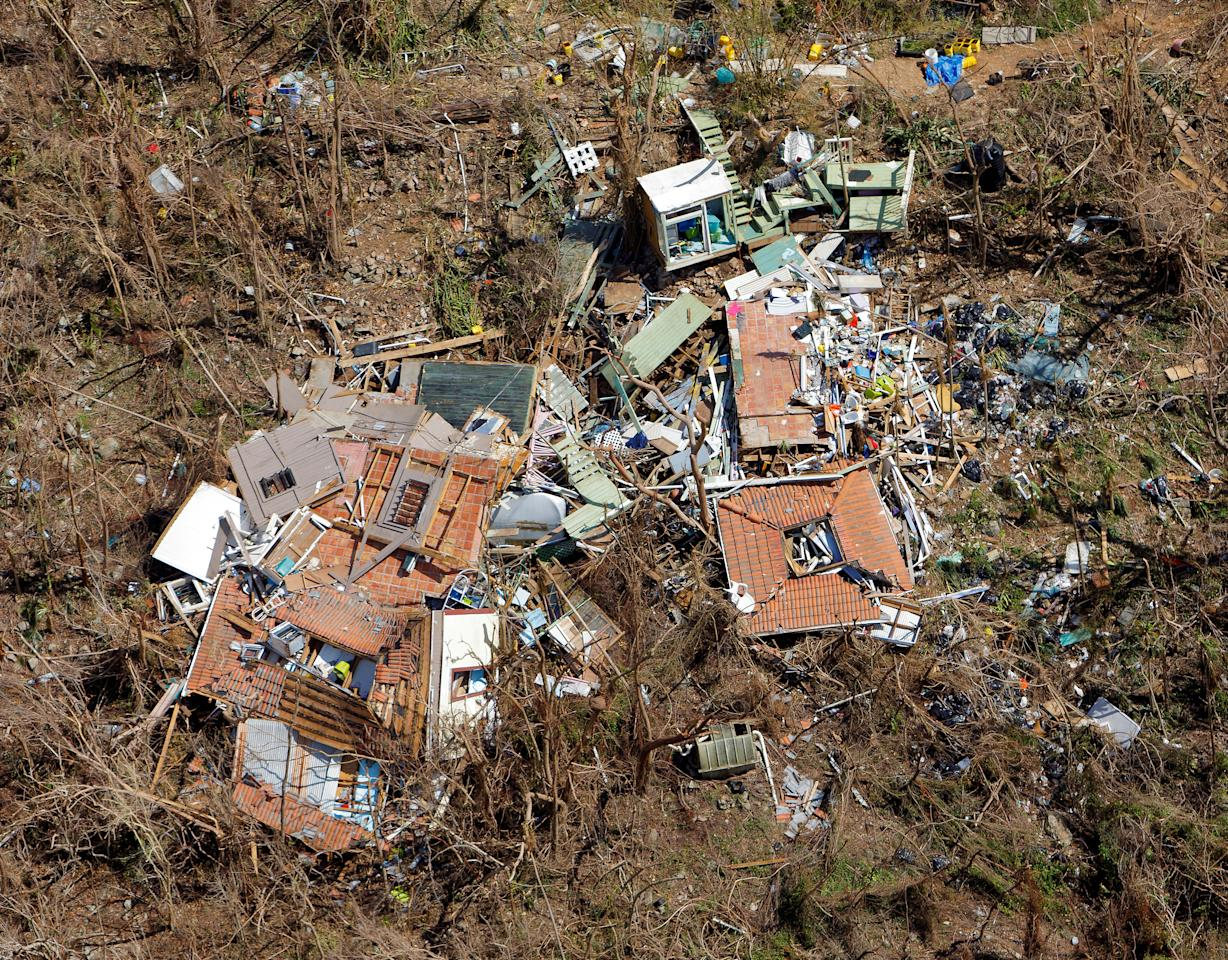 <p>A completely destroyed house is seen 12 days after Hurricane Irma ripped through the island, in the Cruz Bay area of St. John, U.S. Virgin Islands September 16, 2017. (Photo: Jonathan Drake/Reuters) </p>