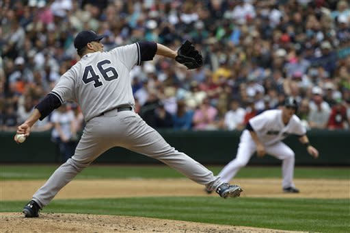 New York Yankees starting pitcher Andy Pettitte (46) throws in the fourth inning of a baseball game against the Seattle Mariners, Saturday, June 8, 2013, in Seattle. (AP Photo/Ted S. Warren)