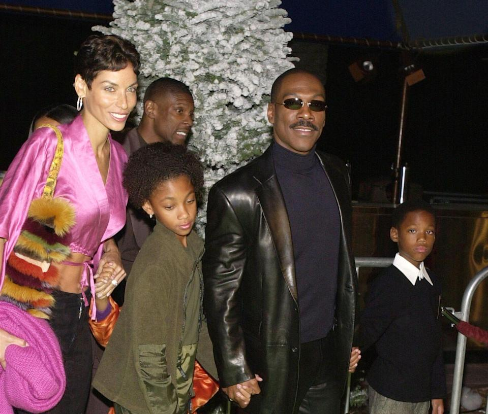 <p>Eddie Murphy walks the red carpet at the premiere of Dr. Seuss's <em>How the Grinch Stole Christmas</em> in November 2000 in Los Angeles with his family.</p>