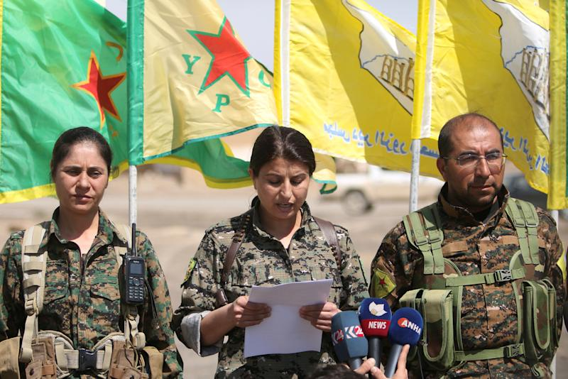 Jihan Sheikh Ahmed (C), the official spokesperson of the Raqqa campaign, talks during a conference, east of Raqqa city, Syria March 26, 2017. REUTERS/Rodi Said