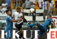 Parma's Hernani, center, duels for the ball with Juventus' Sami Khedira, left, and Juventus' Alex Sandro during the Serie A soccer match between Parma and Juventus at the Tardini stadium, in Parma, Italy, Saturday, Aug. 24, 2019. (AP Photo/Antonio Calanni)