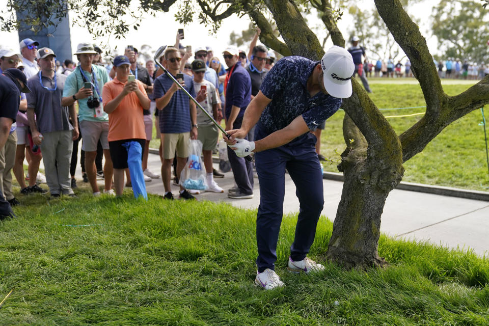 Matthew Wolff hits from the gallery alongside the ninth green during the third round of the U.S. Open Golf Championship, Saturday, June 19, 2021, at Torrey Pines Golf Course in San Diego. (AP Photo/Jae C. Hong)