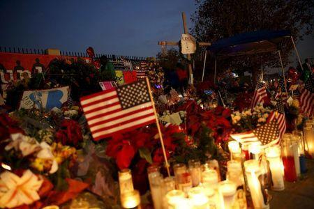 Flowers and candles are displayed at a makeshift memorial after last week's shooting in San Bernardino, California December 10, 2015. REUTERS/Patrick T. Fallon