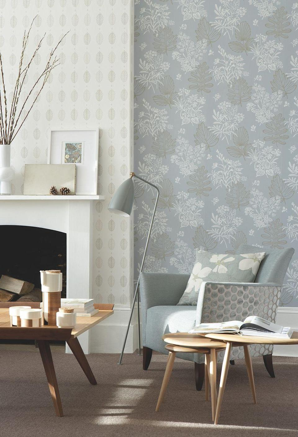 """<p>For an interesting living room wallpaper idea, choose your colour palette then use different patterned wallpapers in different areas. Choose one for the walls and a different one for the chimney breast. It will define the areas in a complementary way. Then follow the theme on the <a href=""""https://www.housebeautiful.com/uk/decorate/g32597929/best-velvet-armchair/"""" rel=""""nofollow noopener"""" target=""""_blank"""" data-ylk=""""slk:armchair"""" class=""""link rapid-noclick-resp"""">armchair</a> with different fabrics on the body of the chair and the sides.</p><p>Pictured: Alcove walls: Norcombe in Welkin; Chimney Breast: Cones in Lint; Skirting and fireplace painted in Shirting no. 129, all <a href=""""https://www.littlegreene.com/"""" rel=""""nofollow noopener"""" target=""""_blank"""" data-ylk=""""slk:Little Greene"""" class=""""link rapid-noclick-resp"""">Little Greene</a></p>"""
