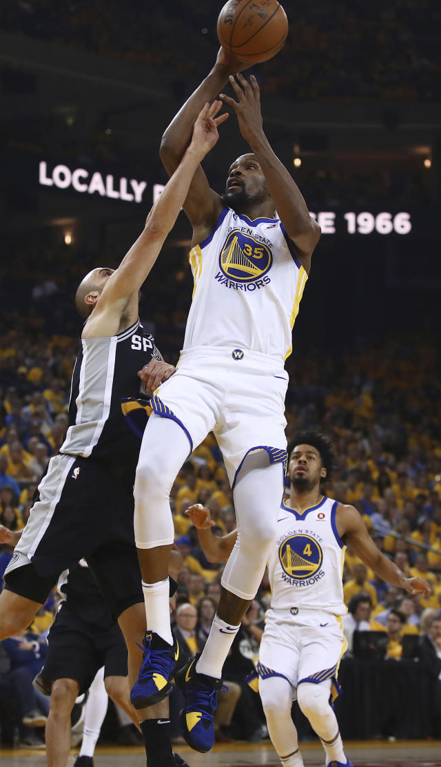 Golden State Warriors' Kevin Durant (35) shoots against San Antonio Spurs' Manu Ginobili, left, during the first quarter in Game 5 of a first-round NBA basketball playoff series Tuesday, April 24, 2018, in Oakland, Calif. (AP Photo/Ben Margot)