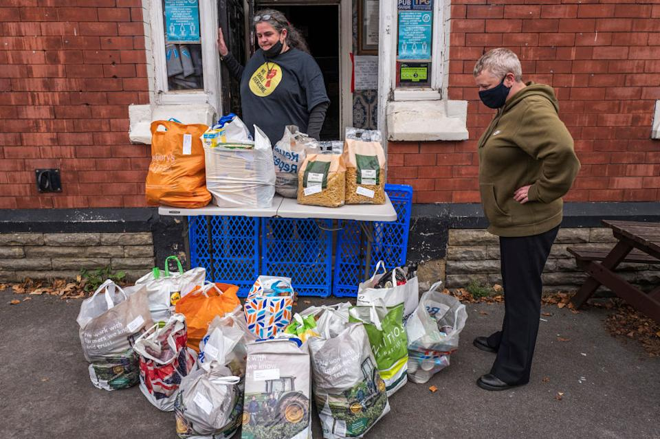 """A food bank accepts a donation on October 20, 2020 in Ashton under Lyne, England.<span class=""""copyright"""">Getty Images—2020 Anthony Devlin</span>"""