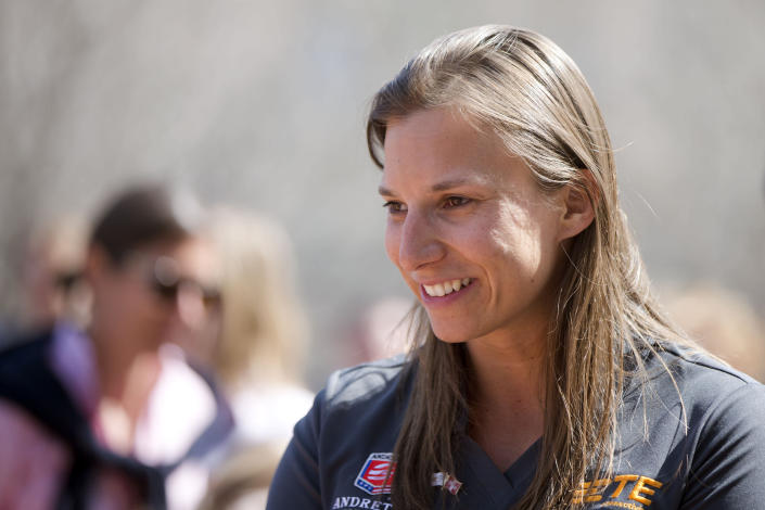 FILE - In this Tuesday, April 2, 2015, file photo, auto racing driver Simona de Silvestro speaks with students during a news conference at the The Franklin Institute in Philadelphia. Beth Paretta and Simona de Silvestro will be teaming up to put another woman on the Indianapolis 500 starting grid this May. On Tuesday, Jan. 19, 2021, Paretta Autosport and IndyCar officials announced they would work together to put a predominantly women-run team in the series' biggest race as part of an outreach to create more diversity in motorsports. (AP Photo/Matt Rourke, File)