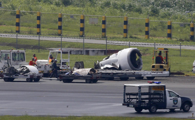 The left engine of Boeing passenger plane from China, a Xiamen Air, sits several meters away on the grassy portion of the runway of the Ninoy Aquino International Airport after it skidded off the runway while landing Friday, Aug. 17, 2018 in suburban Pasay city, southeast of Manila, Philippines. All the passengers and crew of Xiamen Air Flight 8667 were safe and were taken to an airport terminal, where they were given blankets and food before being taken to a hotel. (AP Photo/Bullit Marquez)