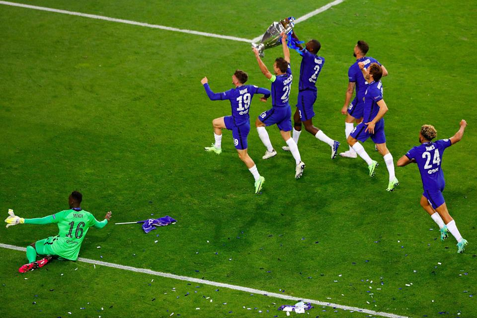 Chelsea players celebrate on the pitch (Getty Images)