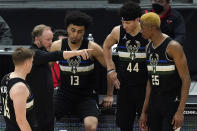 Milwaukee Bucks head coach Mike Budenholzer, second from left, talks to his team during the first half of an NBA basketball game against the Chicago Bulls in Chicago, Sunday, May 16, 2021. (AP Photo/Nam Y. Huh)