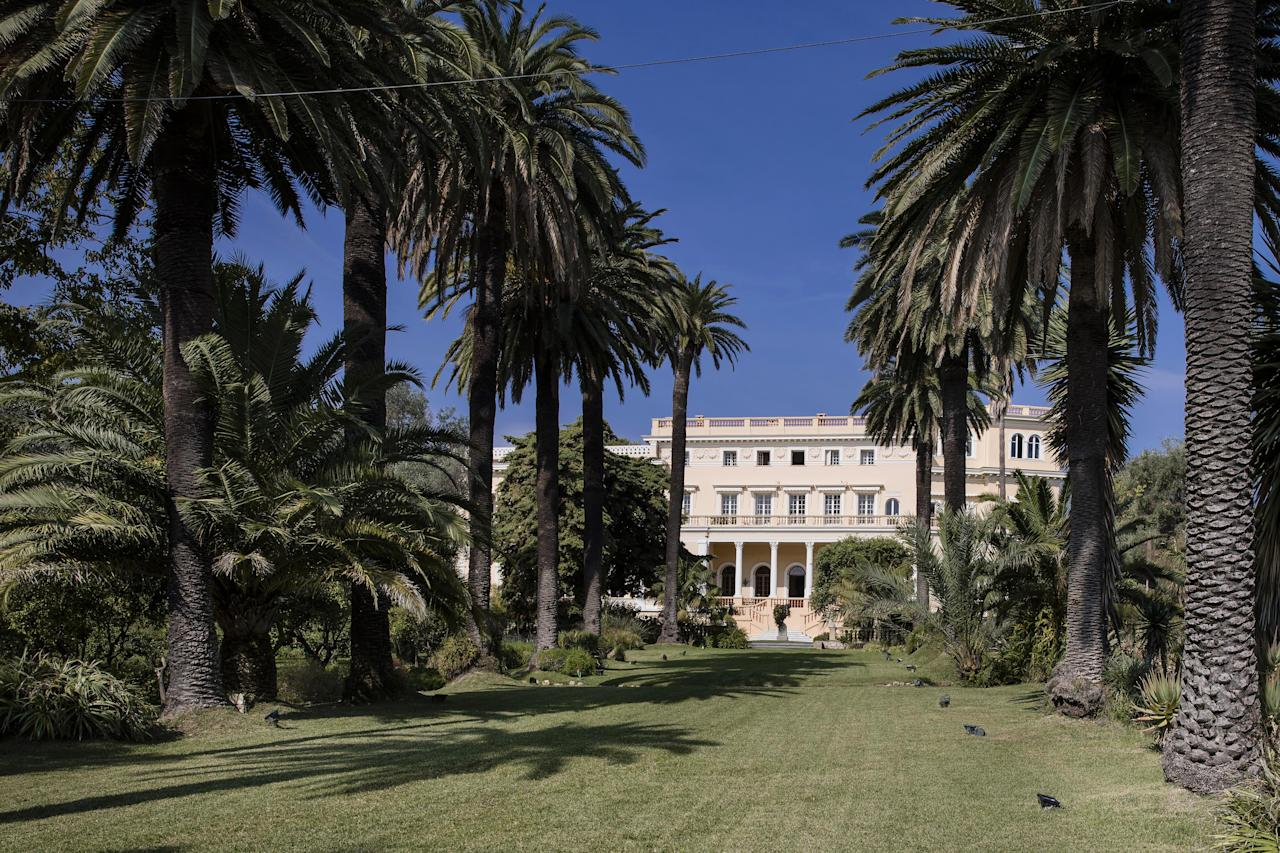 <p>Palm trees line the lawn avenue in the private gardens leading to the Villa Les Cedres, a 187-year-old, 18,000-square-foot, 14-bedroom mansion set in 35 acres, in Saint-Jean-Cap-Ferrat, southern France. </p>