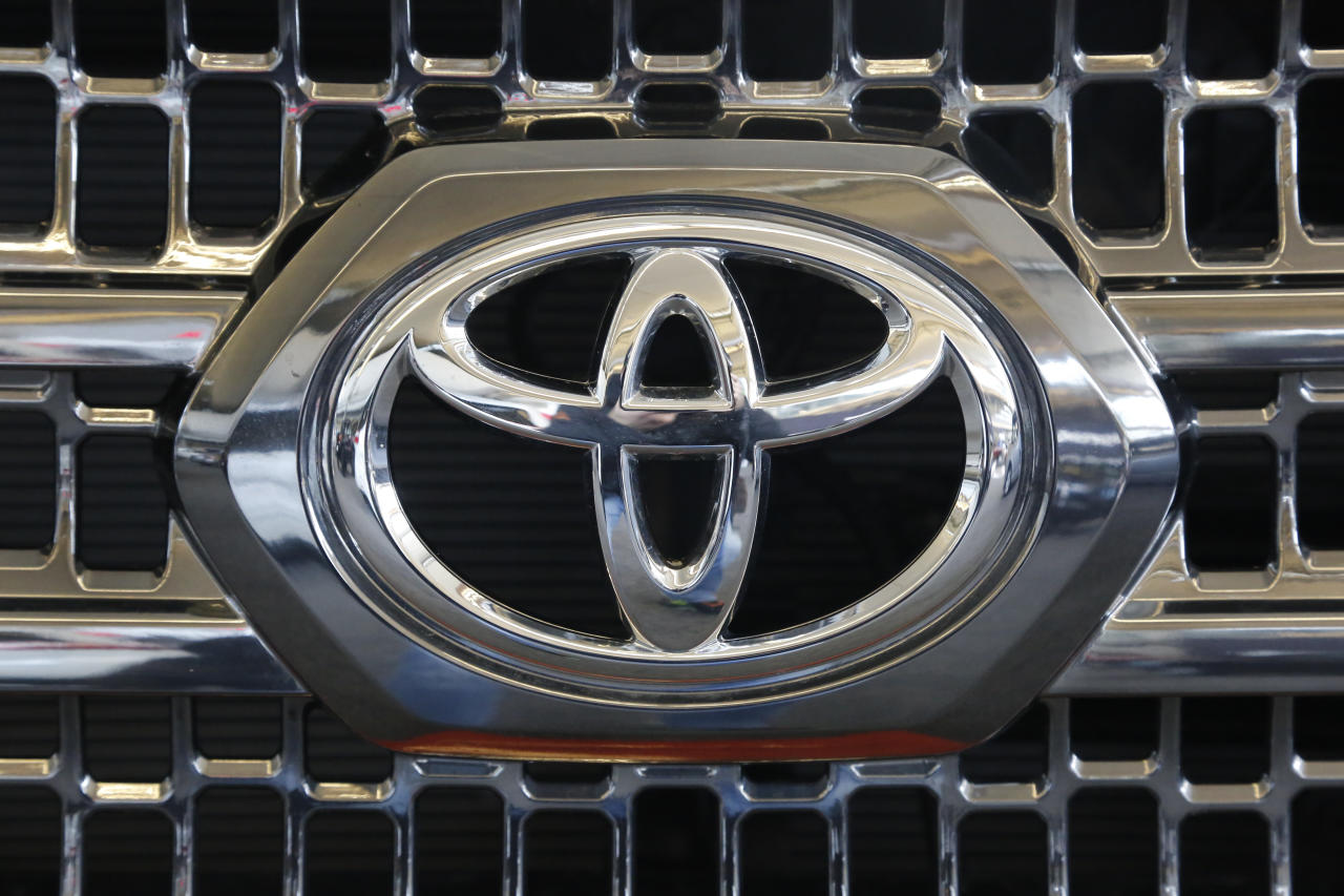 <p> FILE - This Thursday, Feb. 11, 2016, file photo shows the Toyota logo on the grill of a 2016 Toyota Tacoma on display at the Pittsburgh International Auto Show, in Pittsburgh. Toyota is recalling about 250,000 small pickup trucks mainly in North America because the rear wheels have the potential to lock up, causing drivers to lose control. The recall covers certain Tacoma trucks from 2016 and 2017. (AP Photo/Gene J. Puskar, File) </p>