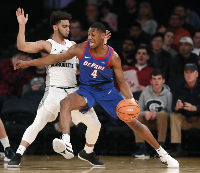 DePaul guard Brandon Cyrus (4) drives up against Marquette guard Markus Howard, left, during the first half of an NCAA college basketball game in the first round of the Big East conference tournament, in New York, Wednesday, March, 7, 2018. (AP Photo/Kathy Willens)