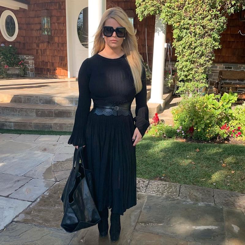 Jessica Simpson poses in a black dress