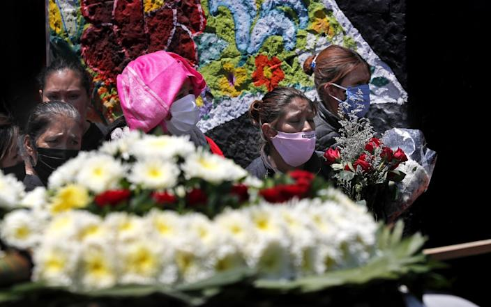 "Relatives wait their turn to enter the San Nicolás Tolentino cemetery in the Mexico City neighborhood of Ixtapalapa for the funeral of their loved one on April 30, 2020. <span class=""copyright"">(Marco Ugarte / Associated Press)</span>"