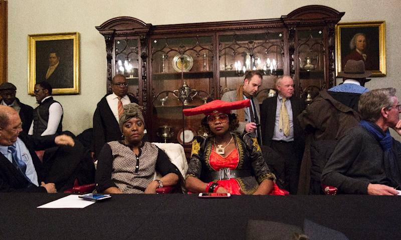Members of the Namibian delegation and members of the press wait for the arrival of Herero chief Vekuii Rukoro to a news conference on March 16, 2017 in New York (AFP Photo/DON EMMERT)