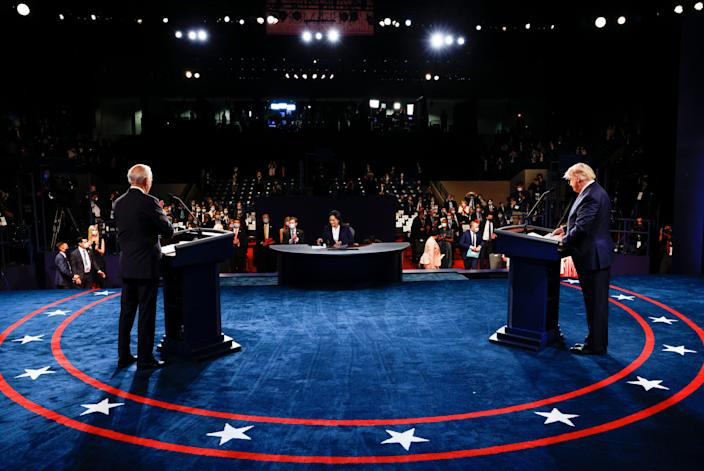 Former Vice President Joe Biden, left, and President Donald Trump debate Thursday, with moderator Kristen Welker in the middle.