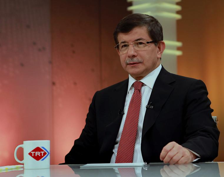 """In this image made available by the Turkish Foreign Ministry, Turkish Foreign Minister Ahmet Davutoglu is seen during an interview with the state-run TRT Television in Ankara, Turkey, Sunday, June 24, 2012. Davutoglu told State TV that Turkey would seek the meeting over article 4 of the NATO charter concerning Friday's incident. The article says member countries """"will consult together whenever, in the opinion of any of them, the territorial integrity, political independence or security of any of the parties is threatened."""" Davutoglu said Sunday that the jet was downed in international airspace after it mistakenly entered Syria, but the plane was not on a spying mission.(AP Photo/Hakan Goktepe, Turkish Foreign Ministry, HO)"""