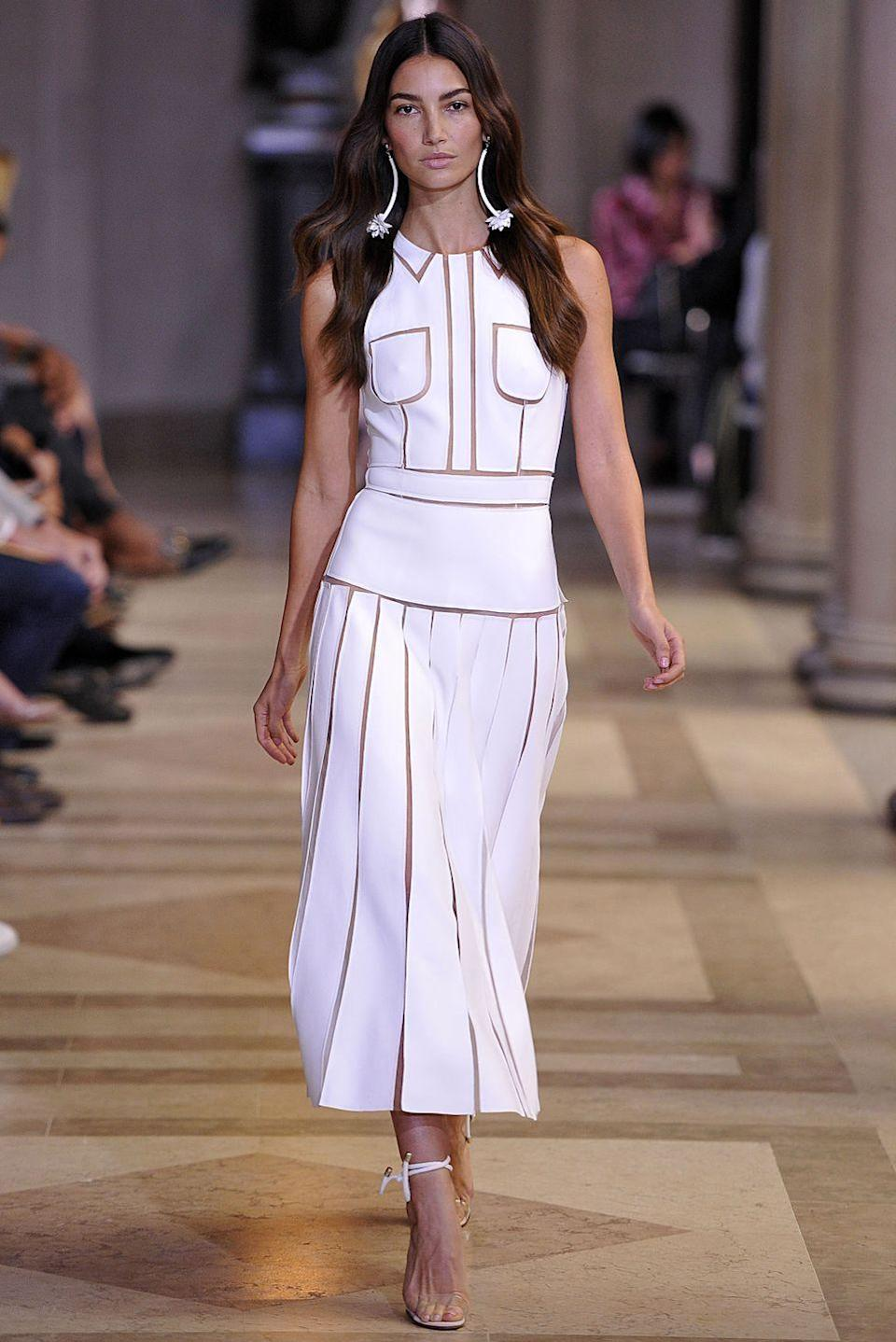 """<p>Aldridge was at her school carnival when she was discovered at the age of 16, according to <em><a href=""""https://www.tatler.com/article/lily-aldridge-red-hot-mama"""" rel=""""nofollow noopener"""" target=""""_blank"""" data-ylk=""""slk:Tatler"""" class=""""link rapid-noclick-resp"""">Tatler</a></em>. Her first job was a campaign for Abercrombie & Fitch.</p><p>Since then, Aldridge has appeared in campaigns for Rag & Bone, Bobbi Brown, Coach, and been named a Victoria's Secret Angel, walking in the brand's runway show each year.</p>"""