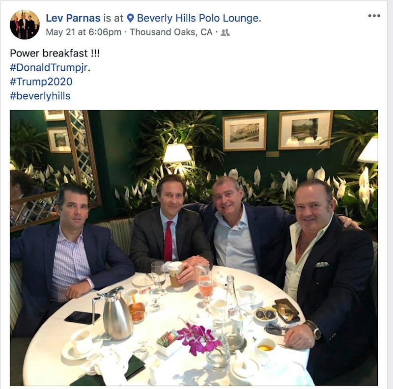 This Facebook screen shot provided by The Campaign Legal Center, shows from left, Donald Trump, Jr., Tommy Hicks, Jr., Lev Parnas and Igor Fruman, posted on May 21, 2018.
