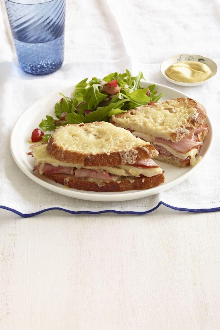 """<p>Inspired by the Croque monsieur, this sandwich delivers melted cheese on the inside <em>and</em> the outside.</p><p><a href=""""https://www.womansday.com/food-recipes/food-drinks/recipes/a12882/broiled-turkey-ham-cheese-sandwiches-recipe-wdy1114/"""" rel=""""nofollow noopener"""" target=""""_blank"""" data-ylk=""""slk:Get the recipe for Broiled Turkey, Ham, and Grilled Cheese."""" class=""""link rapid-noclick-resp""""><strong><em>Get the recipe for Broiled Turkey, Ham, and Grilled Cheese.</em></strong></a></p>"""