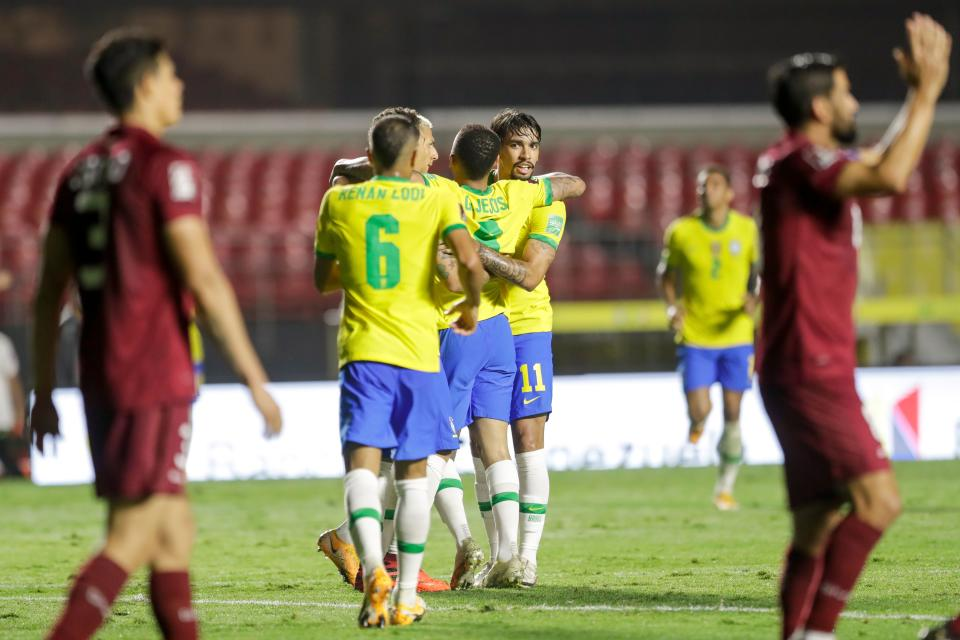 Brazil's Roberto Firmino (covered) celebrates with teammates after scoring against Venezuela during their closed-door 2022 FIFA World Cup South American qualifier football match at Morumbi Stadium in Sao Paulo, Brazil, on November 13, 2020. (Photo by Andre Penner / POOL / AFP) (Photo by ANDRE PENNER/POOL/AFP via Getty Images)