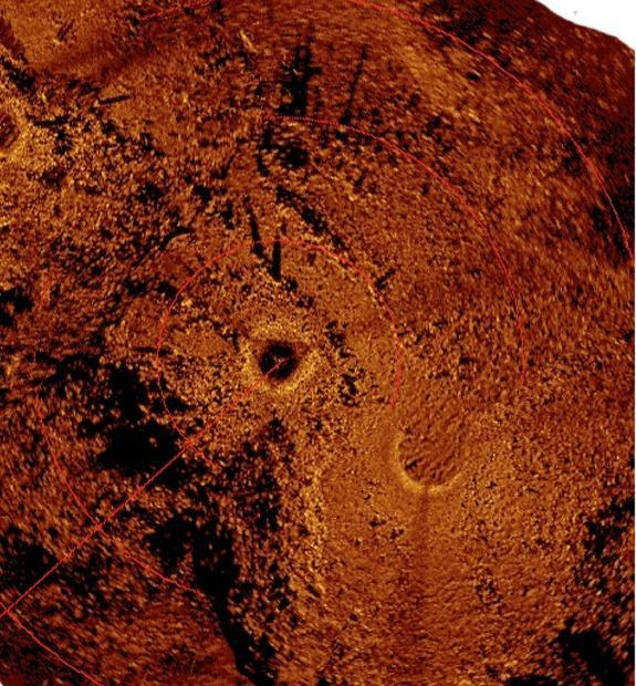 An acoustic image of the ancient caribou hunting site produced via a mosaic of scanning sonar images. (Light colored objects are stones that produce a strong acoustic signature while dark areas are acoustic shadows.)