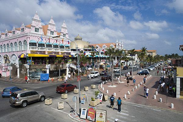 <b>1. Aruba</b><br>Highest income tax rate: 58.95%<br>Average 2010 income: N/A<br><br>Aruba, a Dutch territory, has the highest income tax rate in the world. It is also the only country in the Americas to make the top 10 list.<br><br>The tax rate used to be as high as 60 percent before 2007. The current top marginal rate of 59 percent kicks in at around $165,000. Married individuals have a lower maximum rate of 55.85 percent, compared with single taxpayers at 58.95 percent. Other notable taxes include a capital gains tax of 25 percent, along with health, pension and accident insurance premiums. With an array of social security taxes, Aruba is known to have one of the highest living standards in the Caribbean.<br><br>The small island's exceptionally high tax rate is also much higher than the Caribbean average of 26.7 percent. Islands like the Bahamas, Bermuda and Cayman Islands have no personal income taxes. The closest to Aruba in terms of income tax rates are neighboring South American countries Argentina, Colombia, Ecuador, Guatemala and Venezuela, which have maximum tax rates ranging between 31 percent and 40 percent, according to KPMG.<br><br>Pictured: Oranjestad, Aruba