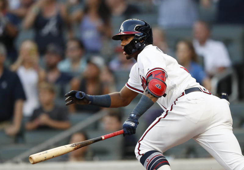 Atlanta Braves' Ronald Acuna Jr. runs to first base after hitting a single in the first inning of a baseball game against the Colorado Rockies on Thursday, Aug. 16, 2018, in Atlanta. (AP Photo/John Bazemore)