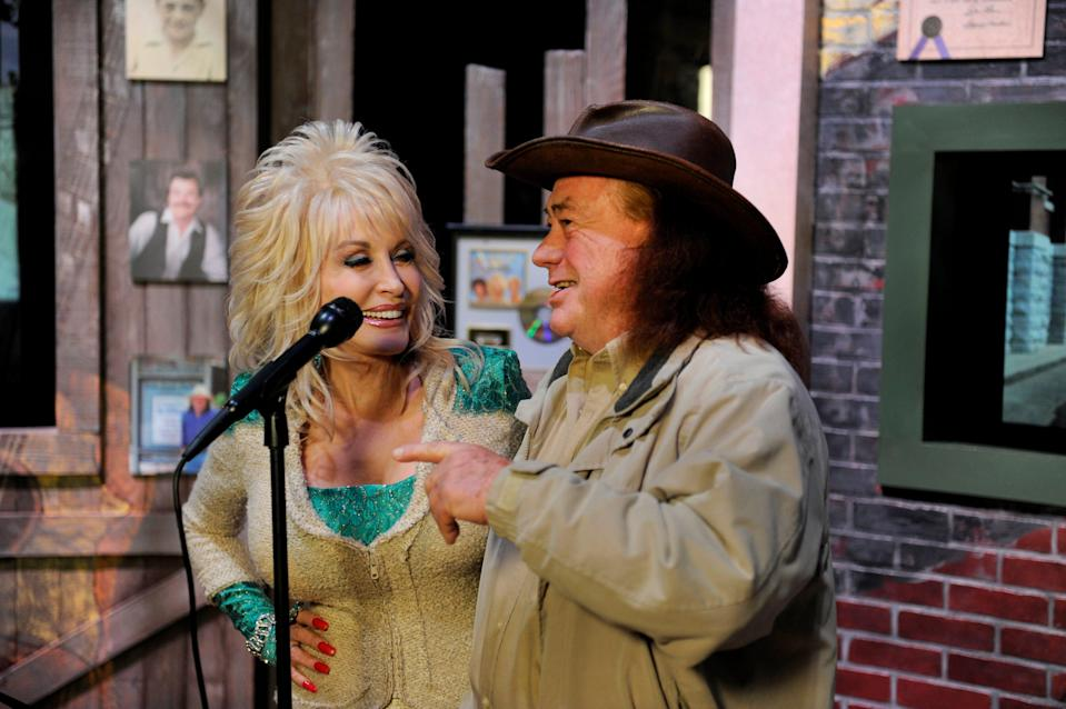 Dolly Parton dedicated a corner of her museum at Dolly to Uncle Bill Owens, the man she credits with helping to launch her career. In a ceremony at Dollywood Friday, Mar. 22, 2013 she and Owens cut the ribbon on the display where she said Owens will appear in person during this year at the park.