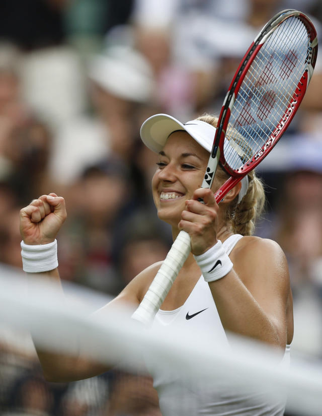 Sabine Lisicki of Germany celebrates winning her first round match against Julia Glushko of Israel at the All England Lawn Tennis Championships in Wimbledon, London, Tuesday, June 24, 2014. (AP Photo/Sang Tan)