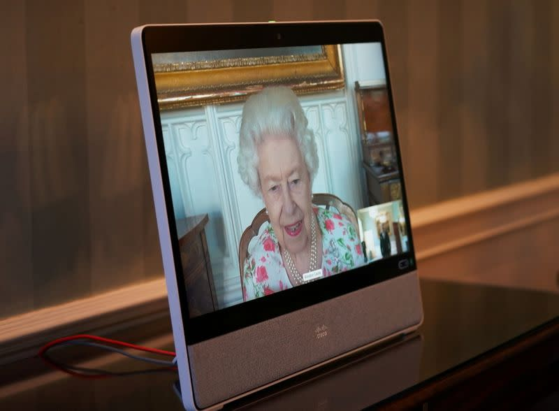 FILE PHOTO: Britain's Queen Elizabeth II appears on a screen via videolink from Windsor Castle, where she is in residence, during a virtual audience to receive His Excellency Dr Zalmai Rassoul, Ambassador from the Islamic Republic of Afghanistan, at Buckin