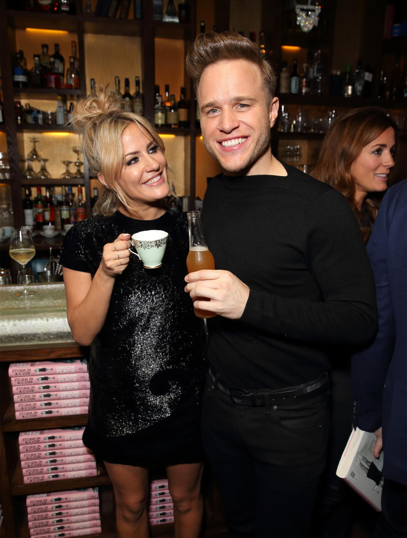 "LONDON, ENGLAND - OCTOBER 21: Caroline Flack and Olly Murs attend the launch of Caroline Flack's new autobiography ""Storm In A C Cup"" at Library on October 21, 2015 in London, England. (Photo by Mike Marsland/WireImage)"